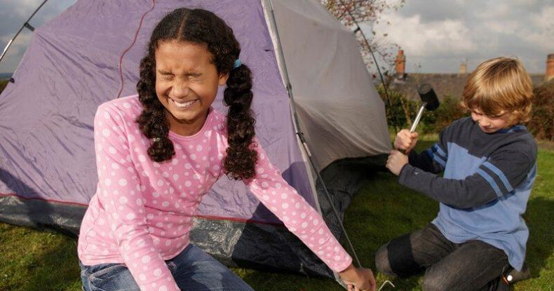 Children pitching tent