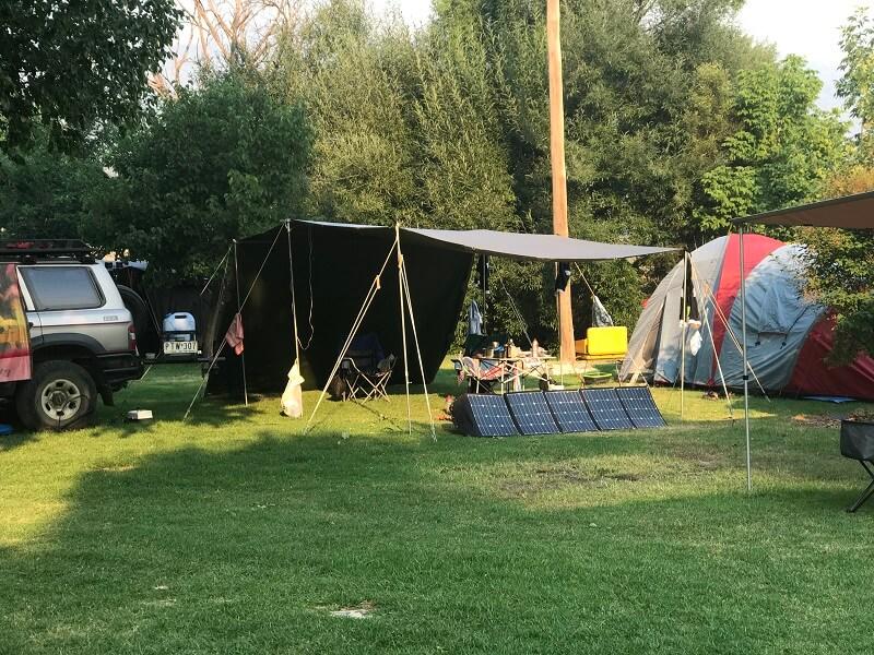 Tent camping setup with tarp